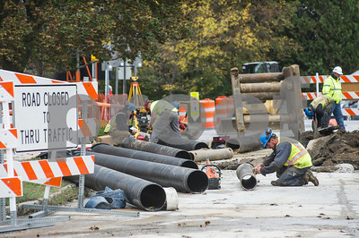 Robert Layman / Staff Photo Workers from Casella work to piece together underground piping after an excavator accidently hit a water main. The main was reportedly incorrectly mapped, and although the construction crew gave ample space for