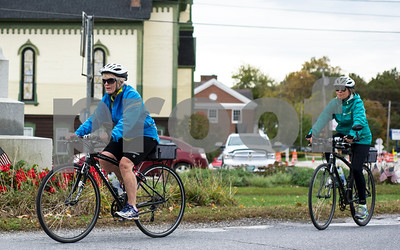 Robert Layman / Staff Photo  A pair of cyclists from Middlebury take off down Park Street in Brandon as they head for Lake Dunmore Wednesday October 11, 2017.