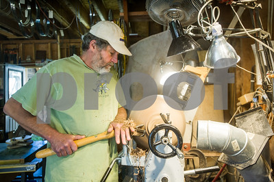 Robert Layman / Staff Photo David Munyak turns a bowl on a lathe at his home studio in Middletown Springs Thursday afternoon. Munyak, who makes furniture, cabinets and wood turned art pieces will be one of the 83 artists participating in Vermont Open Studio week.