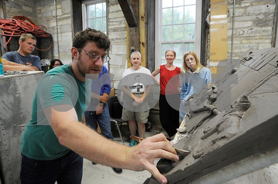 Robert Layman / Staff File Photo Sean Williams, sculptor, does a live modeling critique of the Jungle Book sculpture currently destined for downtown Rutland during a Q & A session at the Carving Studio and Sculpture Center July 19, 2017. Williams took suggestions from the crowd regarding the works perception, scale and intent.