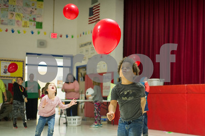 Northwest Elementary School first grader Jordan Barney, right, hits a balloon during the Tapestry afterschool program in the school's gymnasium Wednesday afternoon.