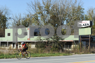 Robert Layman / Staff Photo A road biker heads West on Business Route 4 in front of Flory's Plaza, seen here October 18, 2017.