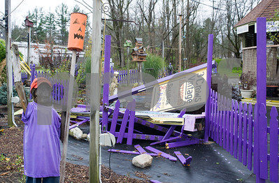Robert Layman / Staff Photo The iconic purple fence and store sign at Mr. Twitter's took a beating in the storm that ran Sunday night to early Monday morning. Luckily, the business, which is right off of Route 7 in Rutland, sustained little damage elswhere on the property, according to clerk Trish Bertino, October 30, 2017.