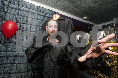 Robert Layman / Staff Photo Heath Arnold reaches out for a scare while participating in Barbara and Gary Spaulding's haunted house on Bellevue Avenue in Rutland Saturday night. The Spaulding family opens up their home every Halloween, this being their 14th, to the public to walk through for spooks and candy. This year, the Spaulding's collected money to donate for the Mentor Connector, which Arnold participates in.