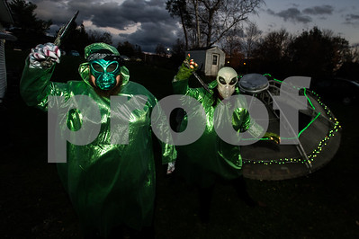 Robert Layman / Staff Photo A pair of spooky aliens pose with daggers outside of Barbara and Gary Spaulding's haunted house on Bellevue Avenue in Rutland Tuesday night. The Spaulding family opens up their home every Halloween, this being their 14th, to the public to walk through for spooks and candy. This year, the Spaulding's collected money to donate for the Mentor Connector.