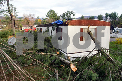 Robert Layman / Staff Photo Seen here is a mobile home at a park in Brandon on Spellman Way that was struck by a tree during the storm late Sunday early Monday night.