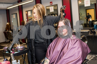 Robert Layman / Staff Photo  Faith Cararra, left, Second year cosmetology student at Stafford Tech,  applies balayage highlights to Lisa Fennimore, who teaches Chef Instruction at STC.