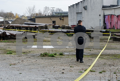 Robert Layman / Staff Photo  Officer Eric Morgano of the Rutland City Police Department patrols the scene of where a woman's body was found in the industrial area near the railroad tracks located off of Post Street.