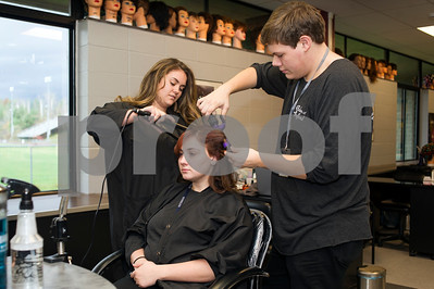 Robert Layman / Staff Photo  Halee Johnson, left, and Terry Potter style Emelie Patterson's hair during cosmetology class at Stafford Technical Center Friday afternoon.