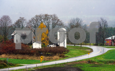 Robert Layman / Staff Photo Rain falls on an old farm house in Tinmouth Monday morning, seen here from Route 140.