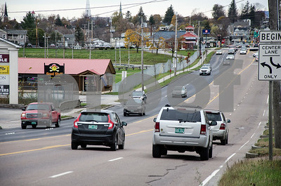 Robert Layman / Staff Photo Traffic opens up on Route 7's southbound lane Tuesday afternoon following a paving operation.