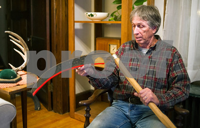 Robert Layman / Staff Photo Mike Canty talks about his scythe that he competes with in the  Addison County Fair and Field Days in his Proctor home Monday, Nov. 7, 2017.