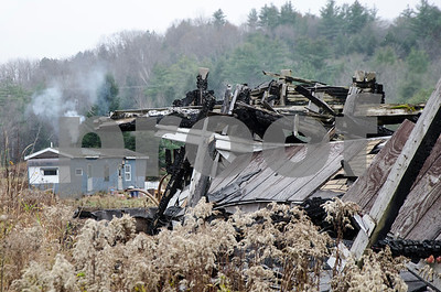 Robert Layman / Staff Photo Remnants of a burned down house can be seen from Route 103 in East Wallingford.