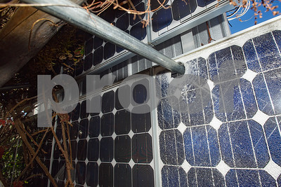 Robert Layman / Staff Photo An impailed solar array panel at Breezy Meadow Orchards in Tinmouth. The array was blown over by the windstorm last week, causing hardship for the offgrid farm which is powered soley by the sun and wind.