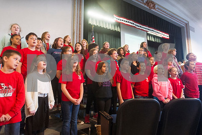 Robert Layman / Staff Photo Members of the Rutland Intermedaite School Chorus sing during the school's Veteran's Day ceremony Thursday morning.