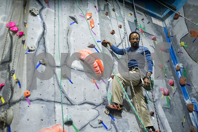 Robert Layman / Staff Photo Ray Hamilton acends the climbing wall during a veterans's retreat with the Vermont Adaptive at the Green Mountain Rock Climbing Center Friday, November 10, 2017.