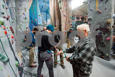 Robert Layman / Staff Photo  Marcus Murphy tries his luck at tying the figure eight follow through during a veteran's retreat with Vermont Adaptive at the Green Mountain Rock Climbing Center Friday, November 10, 2017.