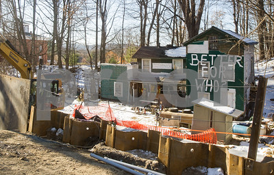 "Robert Layman / Staff Photo Just houses away from a sign sitting along Route 7 that reads ""Building a Better Brandon,"" one home sits on the opposite side a road, with ""Better for who?"" written on its side."