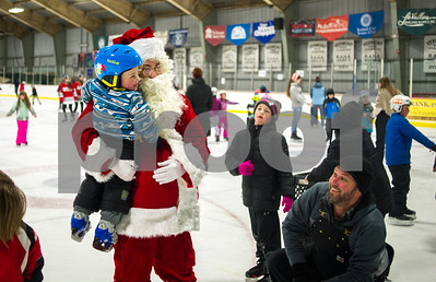 Robert Layman / Staff Photo Santa, aka, TJ Moran, who might just be the worlds best procrastinator, took time out of his busy holiday schedule to skate around with children who showed up in large numbers at the the Giorgetti Arena Thursday, Dec. 21, 2017. Seen here he holds a young Levi Schwanner, 2, as his father, Mike right, watches. According to dad