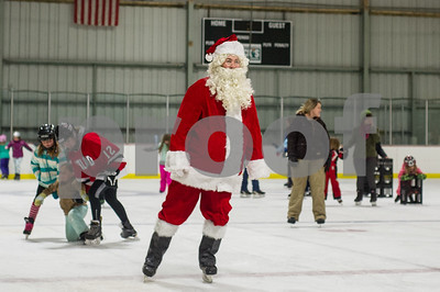 Robert Layman / Staff Photo Despite the upcoming holiday, Santa took time out of his busy schedule to skate around Giogretti Arena Thursday, Dec. 21, 2017. to get last mintue Christmas wishes from children.