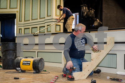 Robert Layman / Staff Photo Tim Shields, of Shields Construction, works on assembling a staircase that will be in the front of rennovated stage at the Brandon Town Hall Wednesday, Dec. 21, 2017. Above him, employee Mark Levasseur, paints the stages floor.