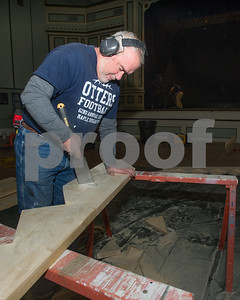 Robert Layman / Staff Photo Tim Shields, of Shields Construction, works on constructing staircase pieces at the Brandon Town Hall Wednesday, Dec. 21, 2017.