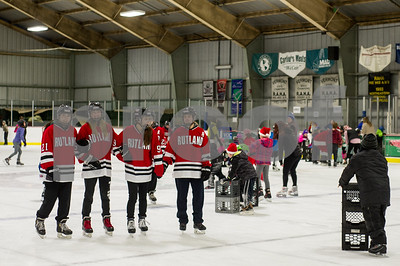 Robert Layman / Staff Photo Members of the Rutland High School hockey team were out to help children around the ice at Giogretti Arena Thursday, Dec. 21. Santa's visit brought dozens of children and parents to the city skating rink.