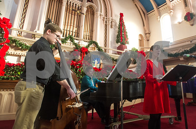 "Titled in an imprompteau introduction by Alistair Stout, Minister of Music at Grace Congregational Church, ""The Great Jazz Trio"" peforms to an elated crowd in the church's sanctuary Thursday, Dec. 21, 2017. Pictured from left to right is, bassist Ben Green, Alistair Stout and saprano singer Allie Griffiths."