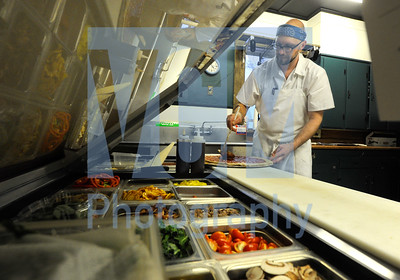 Jeb Wallace-Brodeur / Staff Photo Jimmy Kalp makes a pizza during opening night Thursday for the new Fire Tower Pizza in the Elmore Store in Elmore. Kalp owns the revamped pizza joint with Blair Marvin from Elmore Mountain Bread. The pair use a wide variety of local ingredients including Marvin's own fresh-milled local flour. The shop is open Thursdays thru Sundays from 3-7 p.m.