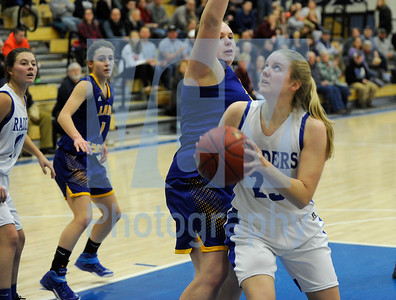 Jeb Wallace-Brodeur / Staff Photo U-32 junior Jayden Hudson works around the defense of Lamoille senior Tara Barney during the first half of their game Friday.