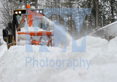 Jeb Wallace-Brodeur / Staff Photo Montpelier sidewalk plow operator Paul Grant inches through deep snowbanks while clearing a sidewalk along Terrace Street in Montpelier Wednesday. Grant began work at 3 a.m., and was unsure when he would be finished with his snow clearing duties.