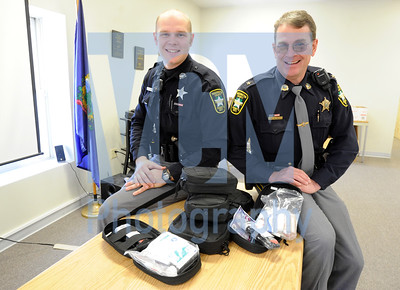 Jeb Wallace-Brodeur / Staff Photo Washington County Sheriff Sam Hill, right, and Deputy Andrew Bent pose Thursday with seven  first aid kits that were donated to the department by St. Michael's Defense of St. Johnsbury, a police, military and hunter's equipment supplier.
