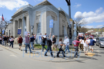 Jeb Wallace-Brodeur / Staff Photo More than 80 American Postal Workers Union members picket outside the Barre post office Friday morning. The postal workers were demanding that their contract, their grievance settlements, and the agreements at labor-management meetings be honored.