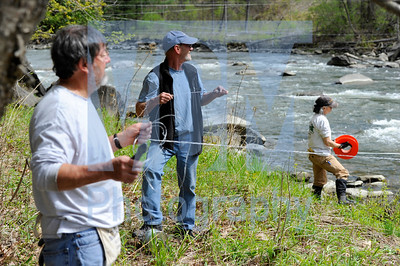 Jeb Wallace-Brodeur / Staff Photo Volunteers arrange cables across the Winooski River in East Montpelier Friday in anticipation of this weekend's Fiddlehead Slalom whitewater canoe and kayak race. From left are Sonny Hunt of Concord, N.H., race founder and director Ray Ingram of Burlington and Lisa Goodman of Burlington. Practice for the event, run between Route 2 and Gallison Hill Road, is Saturday with the race on Sunday.