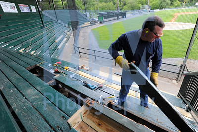 Jeb Wallace-Brodeur / Staff Photo Arne McMullen, Montpelier Recreation Director, removes and replaces rotting boards from the bleachers at historic Recreation Field Friday in anticipation of the Vermont Mountaineers' home opener on Tuesday night against Plymouth.