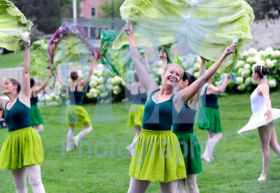 Jeb Wallace-Brodeur / Staff Photo Rini Lovshin-Smith of Shelburne, a dancer with the Farm to Ballet Project, holds a lettuce leaf prop Wednesday night while performing on the Statehouse lawn in Montpelier as part of the third annual Buy Local Market. Organized by the Vermont Agency of Agriculture, the market featured 46 vendors and will be offered again on Oct. 4.