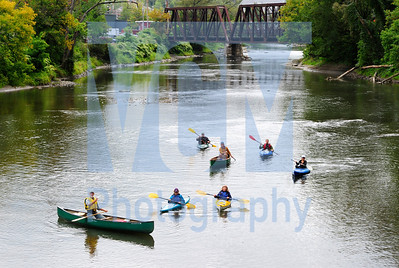 Jeb Wallace-Brodeur / Staff Photo Following a downtown press conference Thursday, boaters representing Lake Champlain International, Vermont Natural Resource Council, the Vermont Chapter of the Sierra Club, and Conservation Law Foundation paddle the Winooski River in Montpelier to highlight the path of pollution as it makes its way past all downstream users to Lake Champlain.