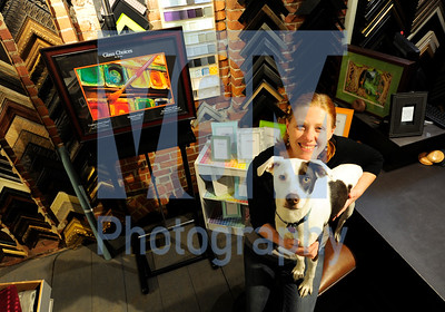 Jeb Wallace-Brodeur / Staff Photo Liz Walsh poses with her dog, Althea, at the Drawing Board in Montpelier Thursday. Walsh, who has worked at the art supply and framing shop for a decade, recently bought the downtown store from longtime owner Jodi Brown.