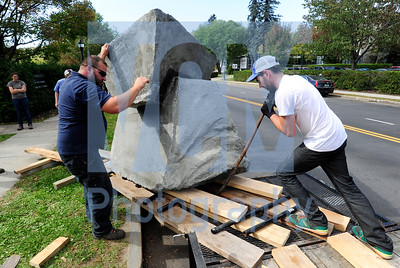 "Jeb Wallace-Brodeur / Staff Photo Justin Kenney, right, of Brattleboro moves his steel and concrete sculpture entitled ""Eating with Morals"" with the help of state grounds supervisor Ira Moser on Wednesday. The sculpture will be displayed on the lawn of the Vermont Arts Council for the next two years and will be part of the Montpelier Alive Art Walk on Friday night."
