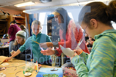 Jeb Wallace-Brodeur / Staff Photo  Vermont artist in residence Gowri Savoor works with Montpelier 7th-grader Anja Rand Friday at the school. Students are creating kinetic wind sculptures that will be displayed outside City Hall as part of ArtSynergy, a project aimed at creating a public art master plan for the city. A public art making session with Savoor will be held at City Hall on Nov. 18th.