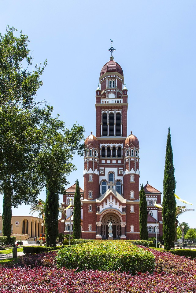.<br /> The Cathedral of Saint John The Evangelist in Lafayette, Louisiana, built in 1916. <br /> <br /> The Cathedral of Saint John the Evangelist or La Cathédrale St-Jean, originally called l'Église St-Jean du Vermilion, is the cathedral and mother church of the Catholic Diocese of Lafayette. It was the first parish in Lafayette Parish, founded in 1821, and was made cathedral upon the erection of the diocese in 1918.<br /> <br /> This historic church is the third structure built on the site. The land was donated in 1821 by Jean Mouton, a wealthy planter who had founded the town as Vermilionville. The church was completed in 1916 in the Dutch Romanesque Revival style, and was listed on the National Register of Historic Places in 1979.  A large red and white brick structure, its notable features include stained glass produced in Munich depicting the life of the patron, oil paintings of Christ and the Apostles, and a Casavant Frères organ.
