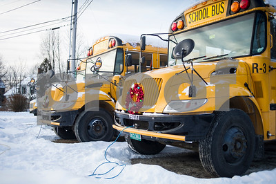 Robert Layman / Staff Photo  Normally these buses would be making their rounds picking up children Wednesday morning, Jan. 3, 2018, and bringing them back to Rutland Town School, but cold weather related issues forced the school to close two consecutive days, extending the holiday break. Seen here, the buses sit at rest with cords plugged into the front to run their block heaters.