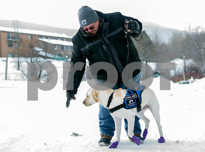Robert Layman / Staff Photo  Navy Veteran Santos Ramos walks with his service dog Prairie around the Mountain Green Resort where he lives, Dec. 29, 2017.