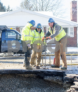 "Robert Layman / Staff Photo  Members of Rutland City Department of Public Works finish up a water main repair on Plain Street, Wednesday January 3, 2018 following a rupture of a 6"" main, which DPW technician Pete Kelley said dates back to 1893."