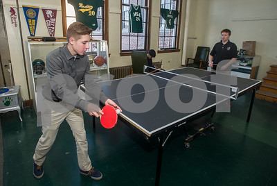Robert Layman / Staff Photo  Ezra Robichaud, left, Mount St. Joseph sophomore, serves a ping pong ball to opponent Roahan McGee at the school's Wave Cave Wednesday afternoon. The Wave Cave just opened up to accept local teenagers from MSJ and other schools in an expansion by the Rutland County Boys & Girls Club.