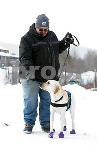 Robert Layman / Staff Photo Santos Ramos walks with his service dog around the Mountain Green Resort Friday, Dec. 29, 2017.