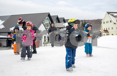 Robert Layman / Staff Photo  Killington Elementary School students walk onto the learning area outside Ramshead Lodge at Killington Ski Resort Thursday, Jan. 11, 2018.
