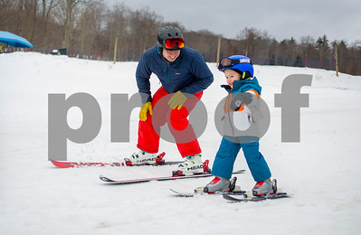Robert Layman / Staff Photo  Justin Guth, Risk Manager at Killington Ski Resort, teaches his son Jonah, who is also a Killington Elementary School student how to ski Friday afternoon, Jan 11, 2018. Guth joined other KES parents on the snow Friday afternoon to help teach their offspring how to ski.