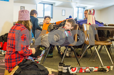 Robert Layman / Staff Photo  A Killington Elementary School student gives it all he can while lunging forward while being fit Thursday afternoon in the Ramshead Lodge at Killington Ski Resort, Jan. 11, 2018.