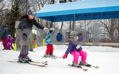 Robert Layman / Staff Photo Killington Elementary School Principal Betty Hughes, left, helps student Abby Reed learn posture during her ski lesson Thursday, Jan. 11, 2018.